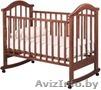 Кроватка детская РИО модель Виктория-2 колесо/качалка,  автоспинка,  цвет орех