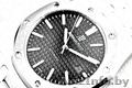 Часы Royal Oak с черным циферблатом.